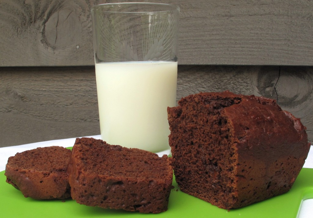 Chocolate Yogurt Loaf Cake sliced with glass of milk