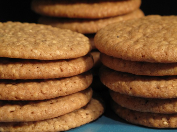 = Sesame Benne Wafers close up in stacks showing the thin, rounded edge.