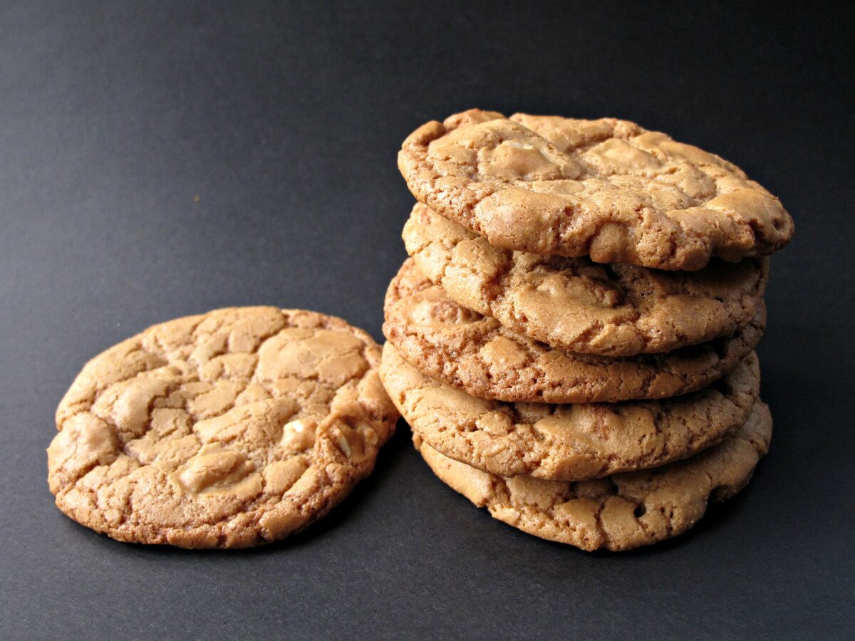 Stack of cookies on black background.