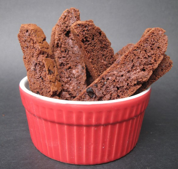 Chocolate Espresso Biscotti standing in a red bowl.