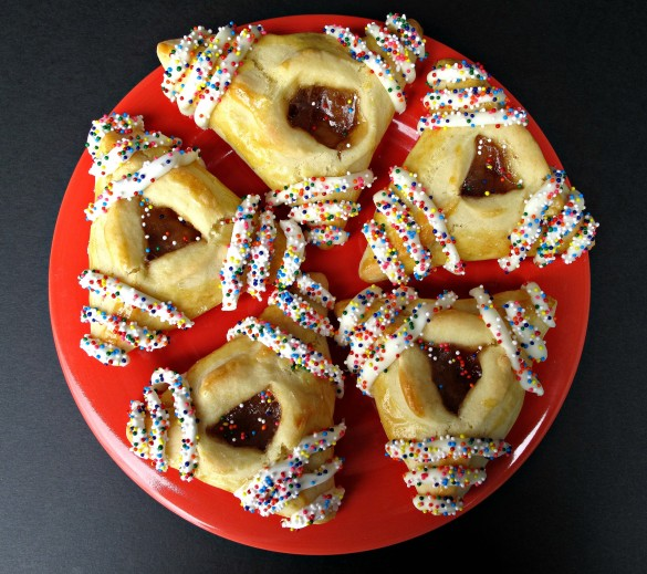 Hamantashen Pocket Cookies on red plate