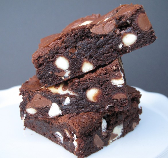 Stack of Hugs and Kisses Brownies on a white plate.