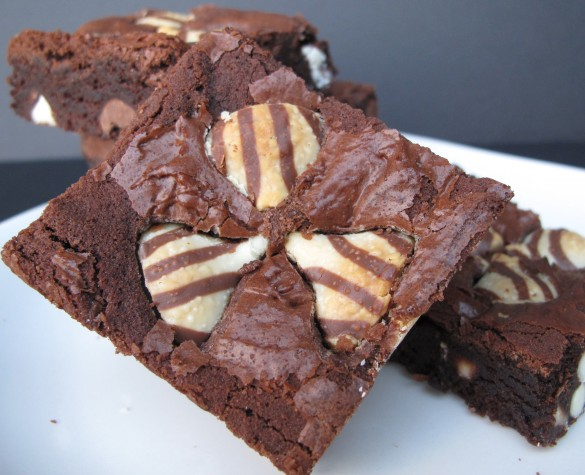 Top of brownie with three stripped candy kisses embedded on top.