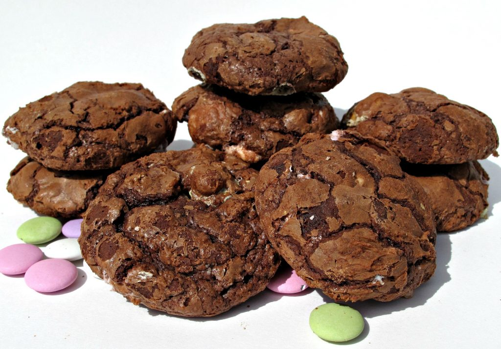 Flourless Chocolate Cookies with pastel colored mint lentil candy.