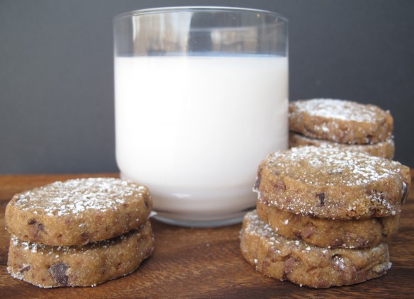 two piles of Espresso Chocolate Shortbread Cookies and a glass of milk