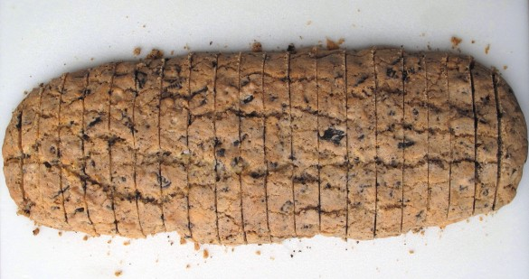 Baked dough log sliced into biscotti.