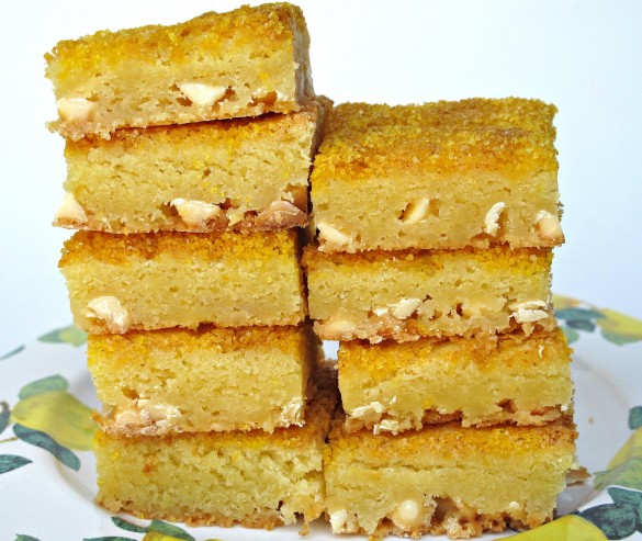 Chewy White Chocolate Lemon Bars- creamy white chocolate and lemon zing combine into a soft, chewy citrus bar! This desert-safe recipe travels well for care packages or picinics!   The Monday Box
