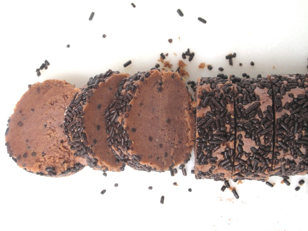 Chocolate Slice-and-Bake Sprinkle Chubbies sliced from the dough log.