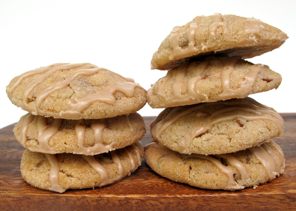 Two stacks of Cinnamon Dream Cookies on a wooden base
