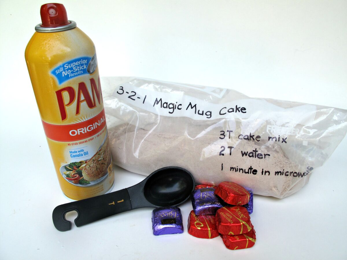 Recipe ingredients for 3-2-1 Molten Lava Mug Cake including Pam, chocolates, and mug cake mix.