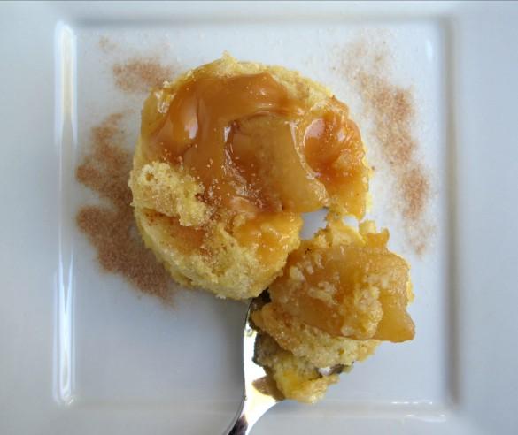 Apples and cinnamon on top of a Caramel Apple Mug Cake