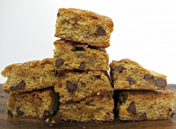 Chocolate Chip Cookie Bars stacks with lots of chocolate chips inside