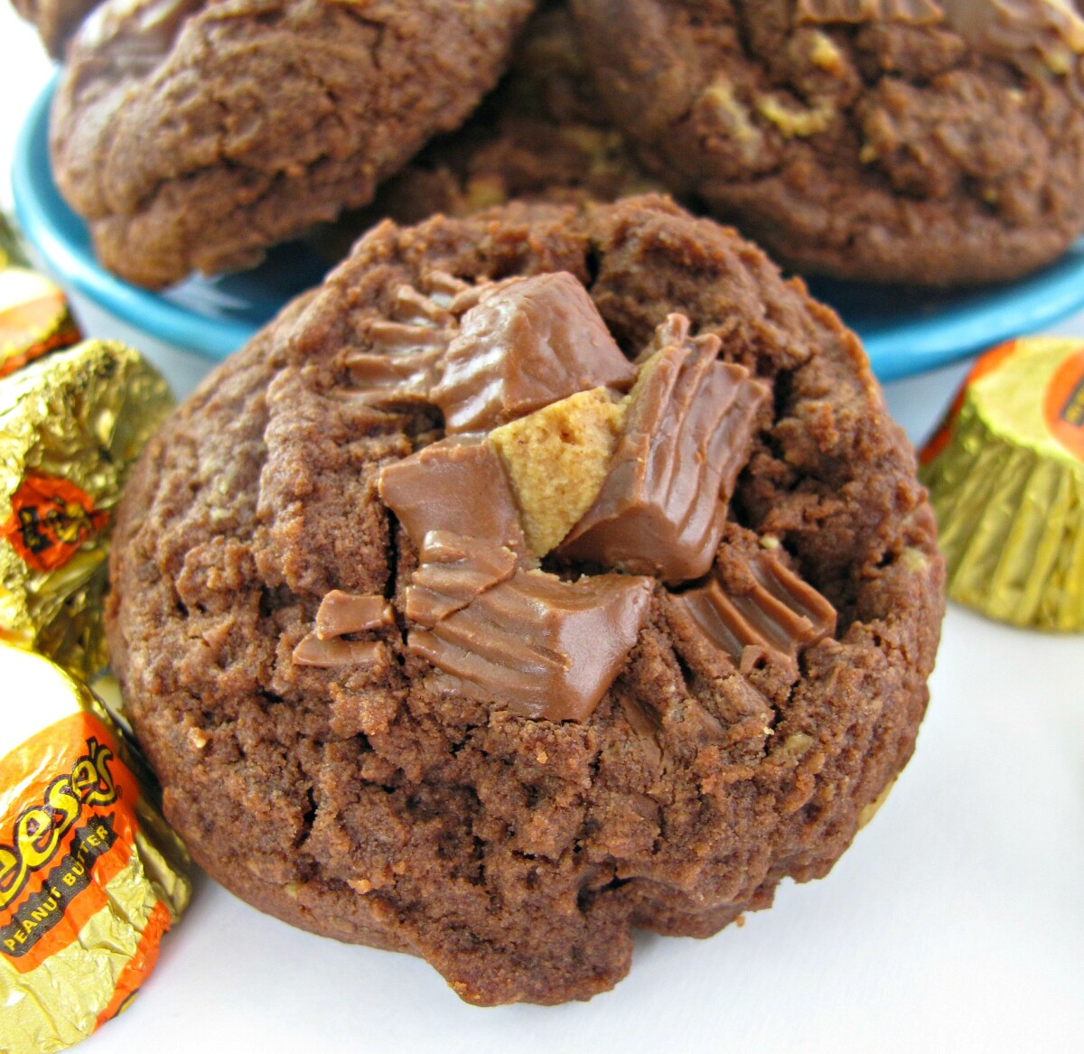 Closeup of a Chocolate Peanut Butter Cup Cookie with chopped peanut butter cup candy on top.