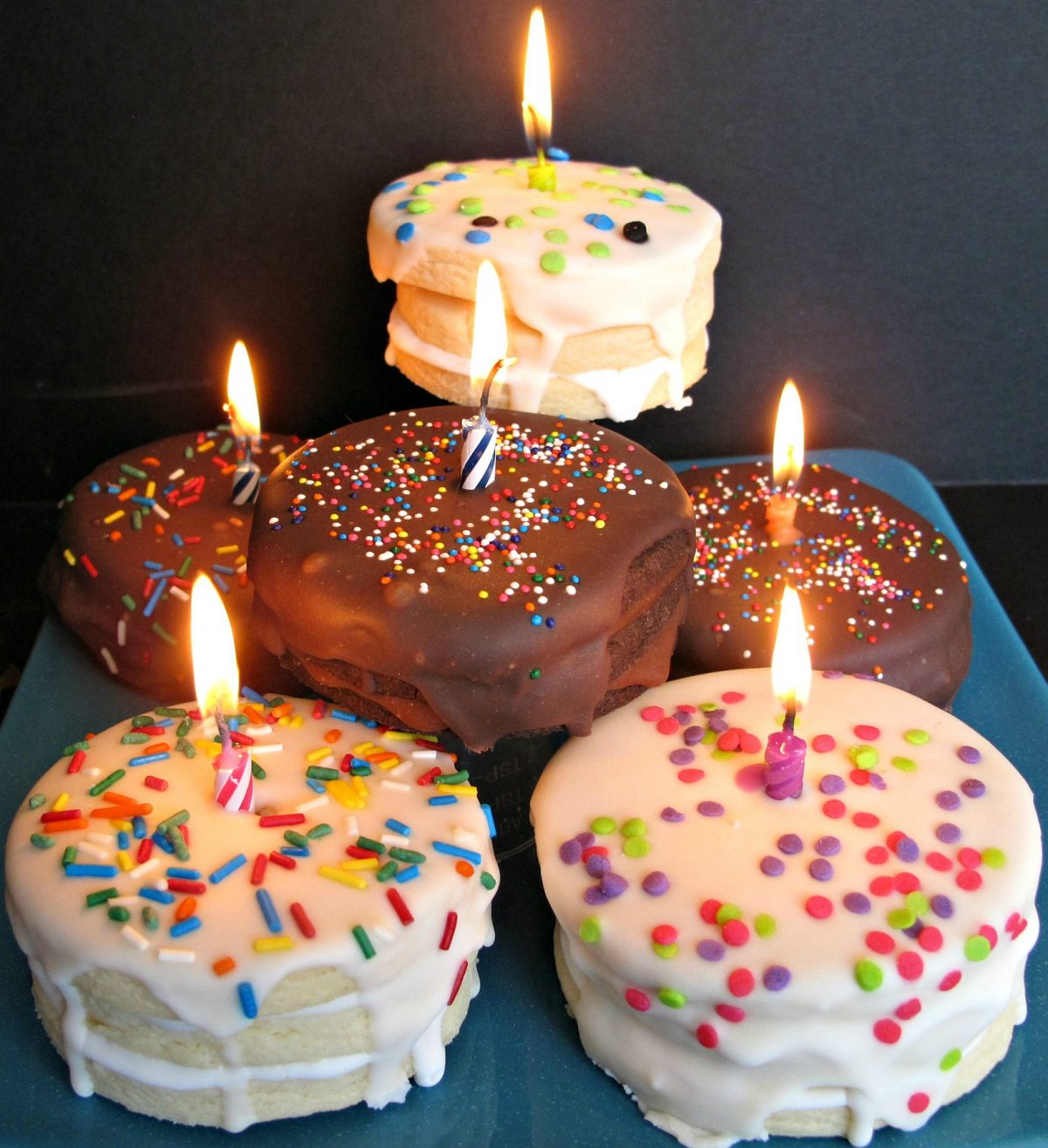 Birthday Cake Surprise Cookies that look like little birthday cakes with lit candles on top.