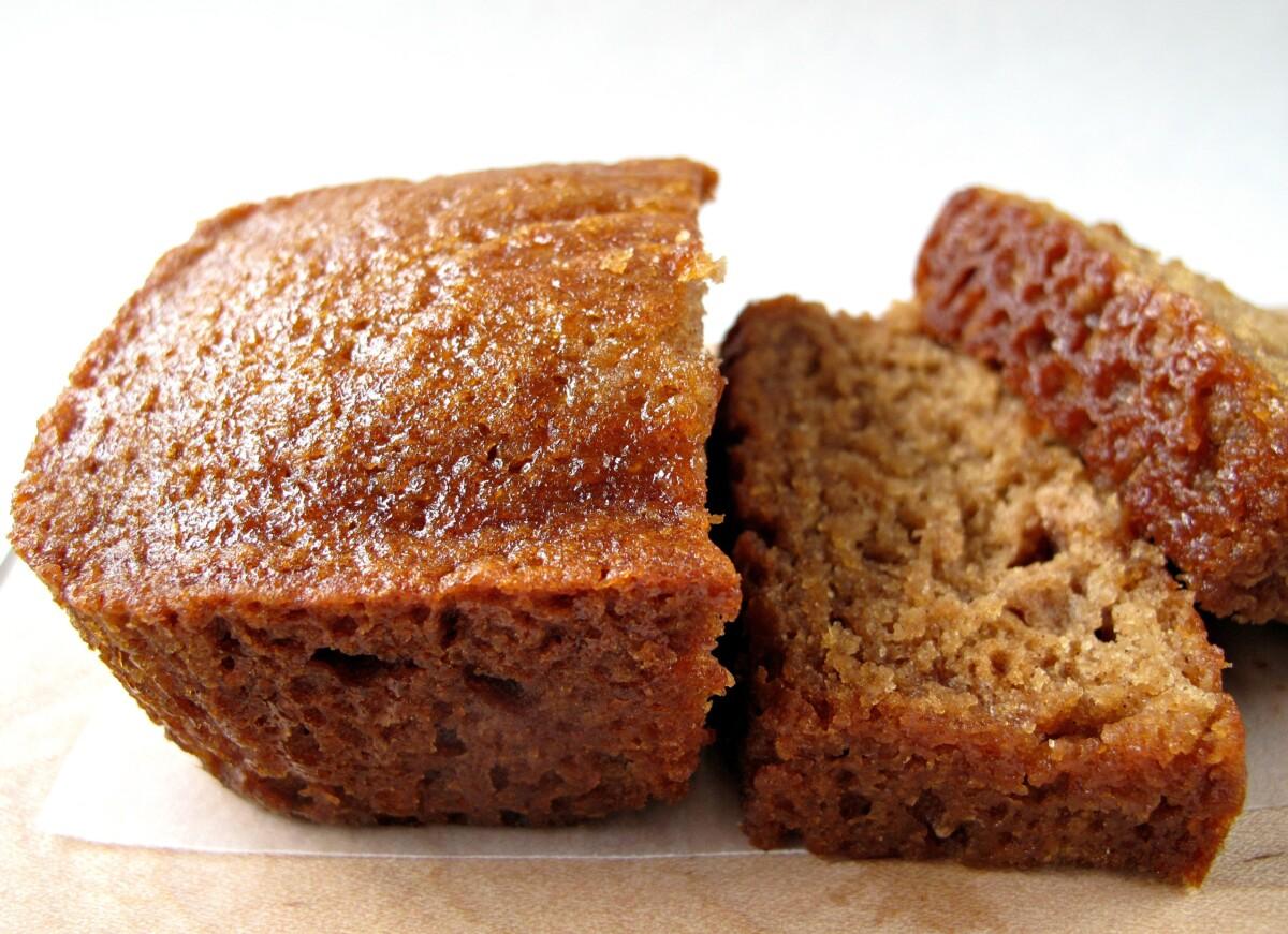 A sliced loaf of shiny, moist Honey Cake close up.