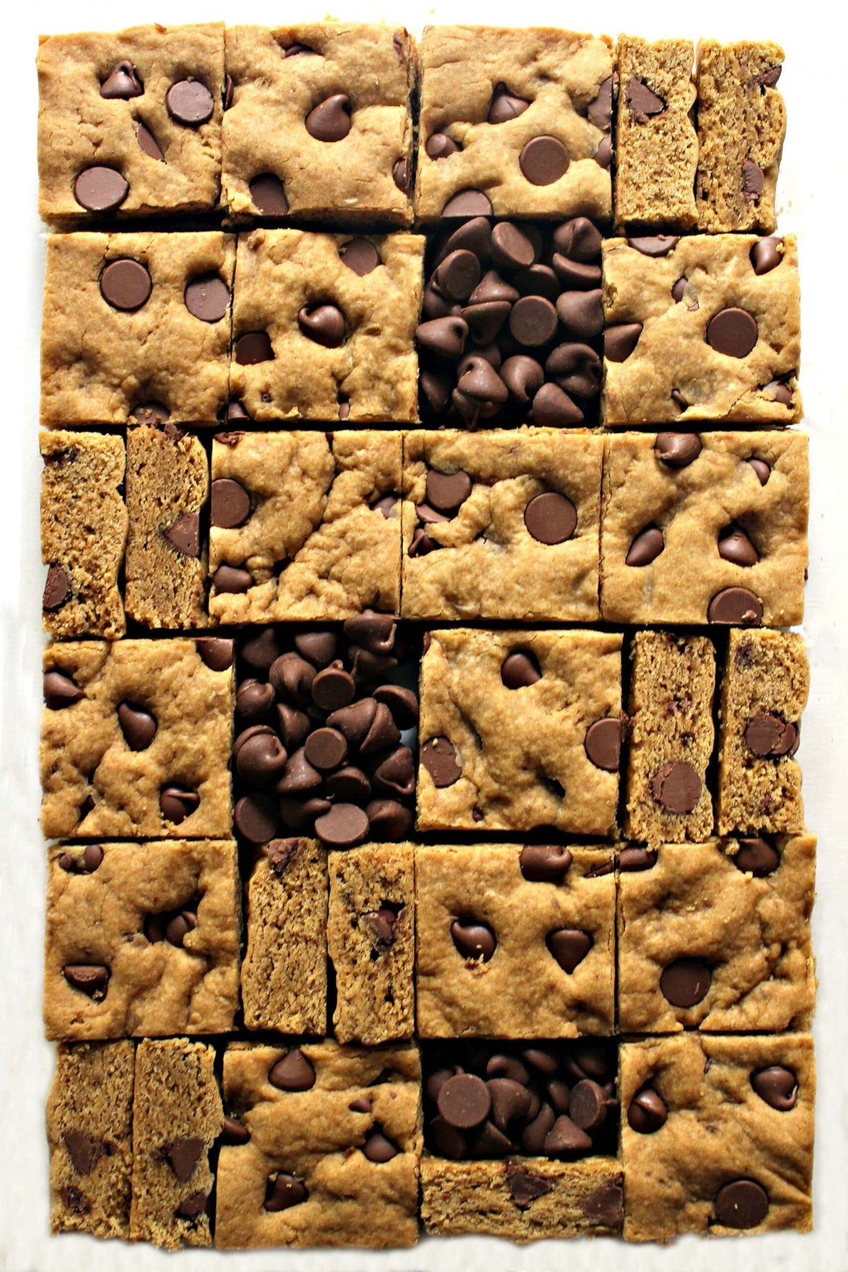 Peanut Butter Chocolate Chip Bars cut in squares.