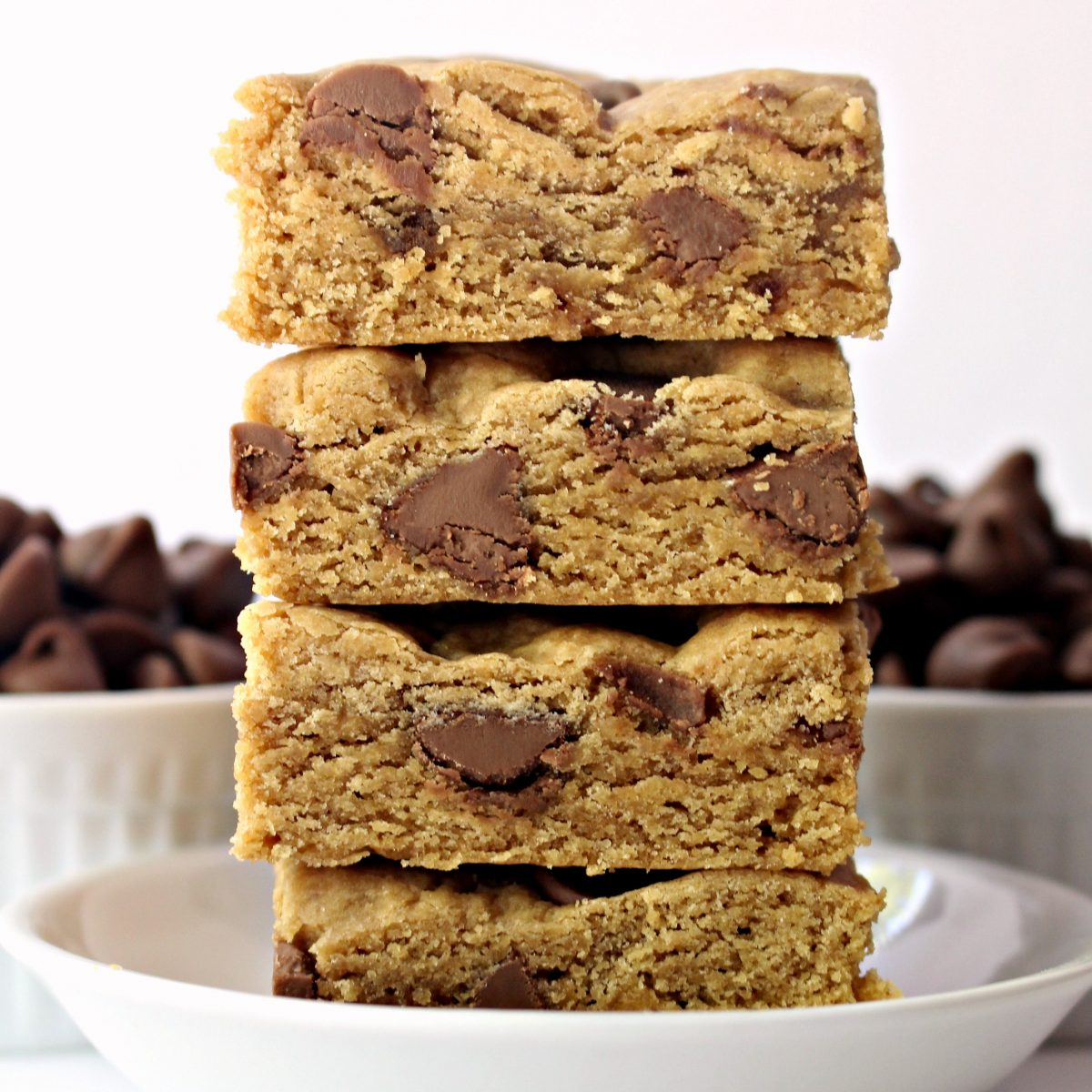 Stack of cookie bars from side showing thick, chewy interior.