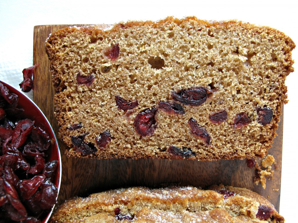 One slice of Cranberry Clementine Whole Wheat Quick Bread showing interior of loaf studded with cranberries