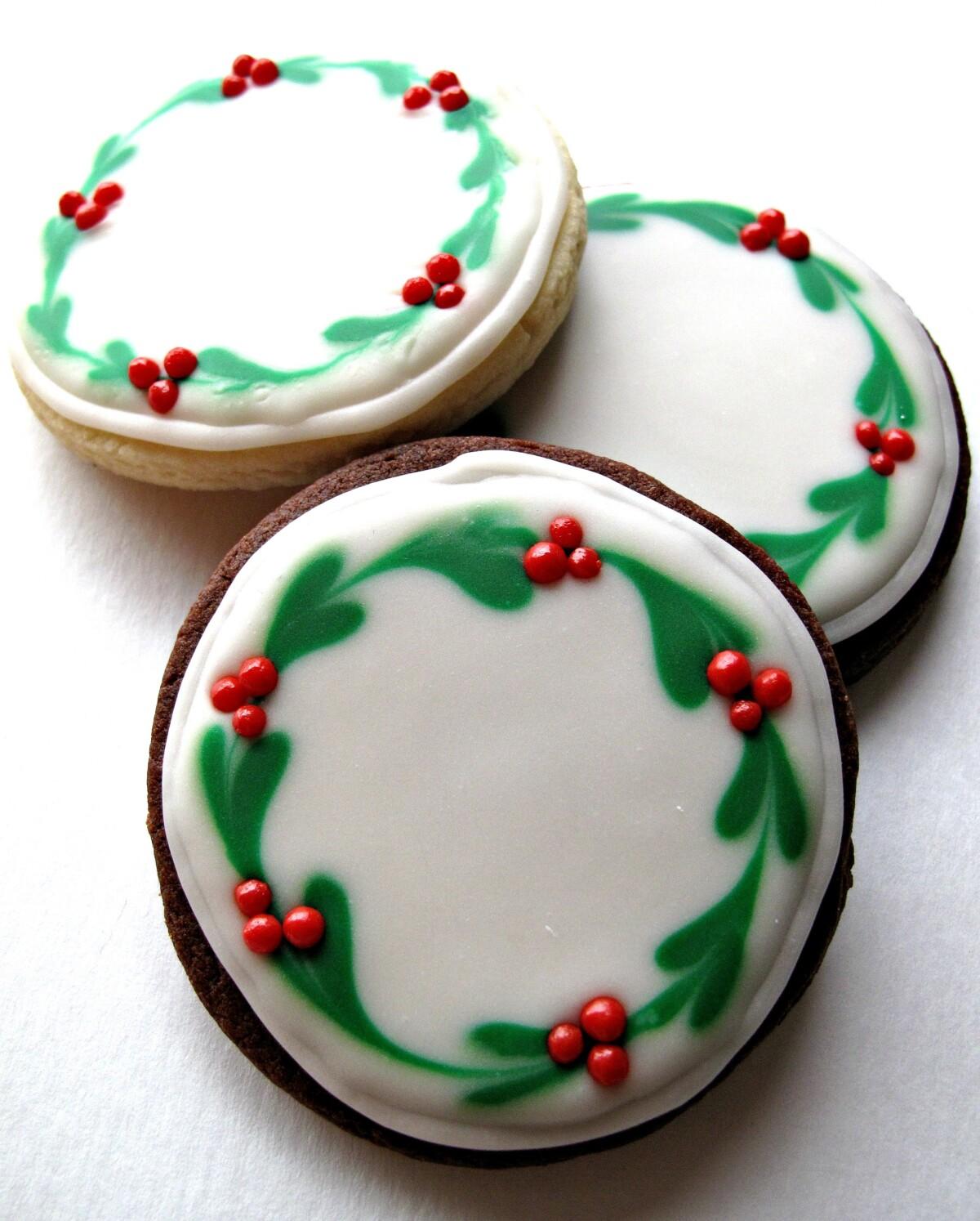 Iced Christmas Sugar Cookies with Christmas wreath designs.
