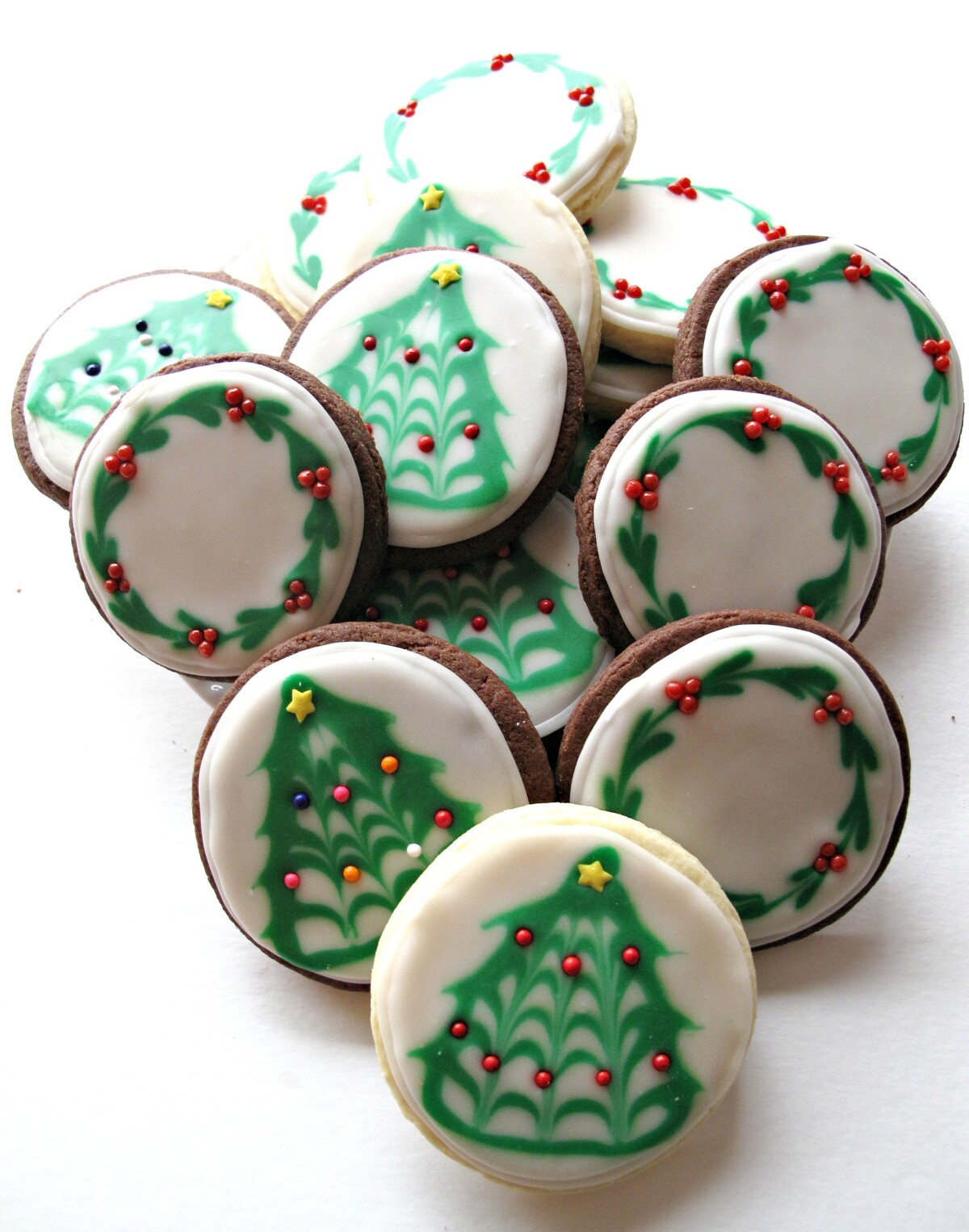 Iced Christmas Sugar Cookies with Christmas tree and wreath designs.