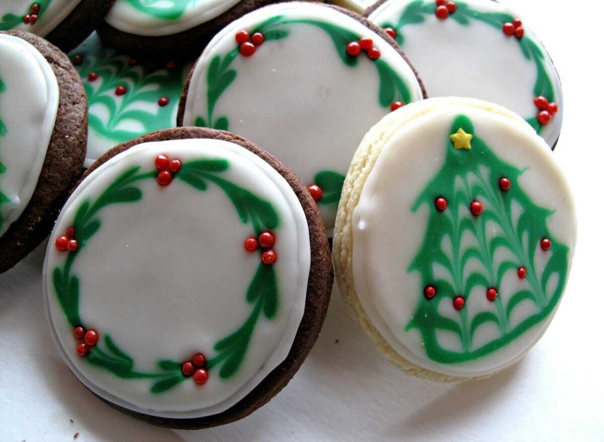 Sugar Cookies with Christmas tree and wreath designs in a pile.