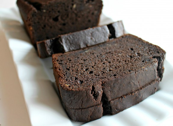 Chocolate-Maple Banana (or not) Bread sliced on a white platter