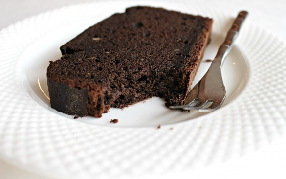 1 partially eaten slice of Chocolate-Maple Banana (or not) Bread on a plate with a fork