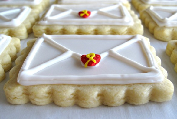 """Valentine Envelope Sugar Cookies edge closeup showing ¼"""" thickness of the scalloped edge and the 3-dimensional icing with the envelope lines piped on top of the flat white icing."""