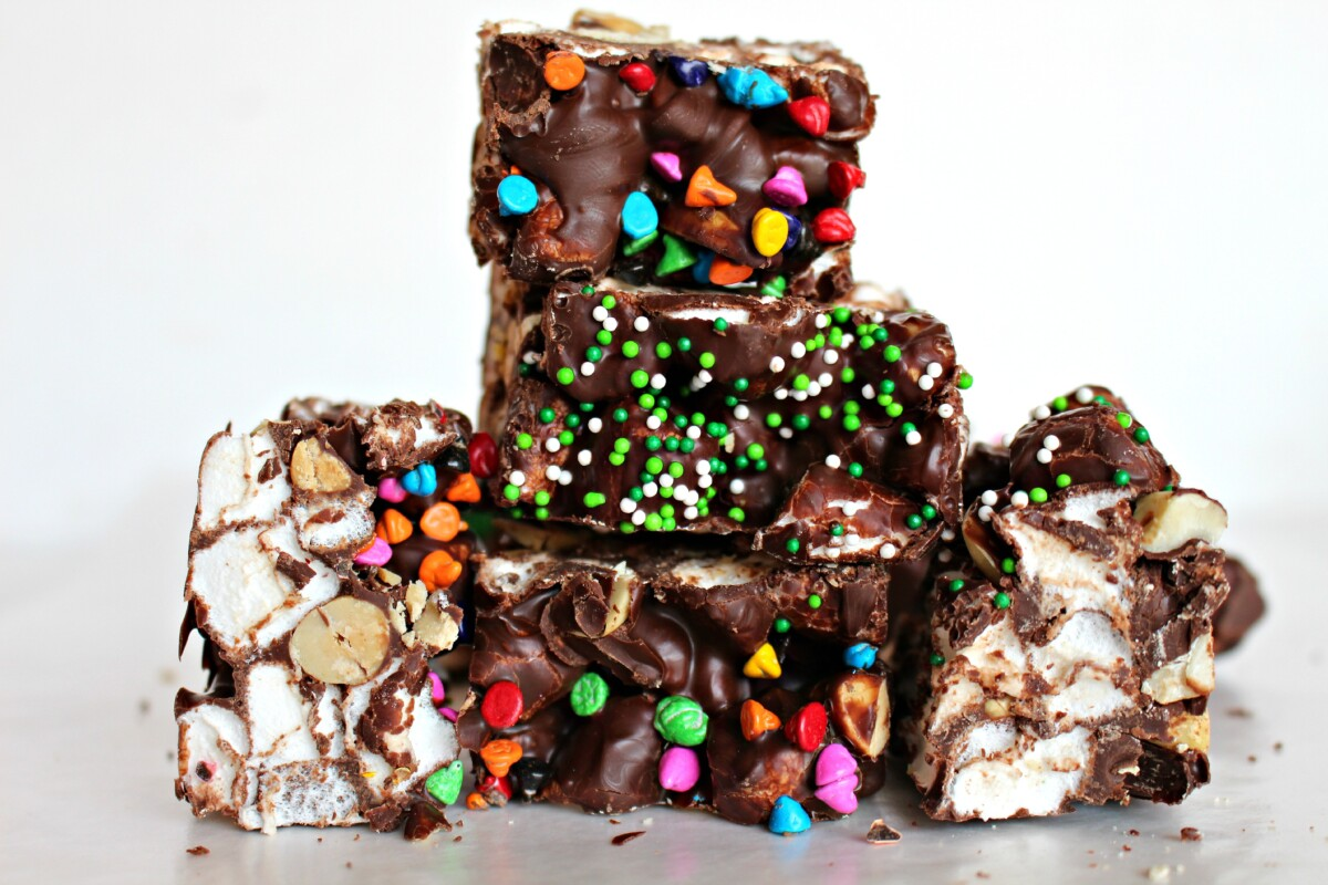 Closeup of thick cut edge with marshmallows and peanuts surrounded by chocolate.