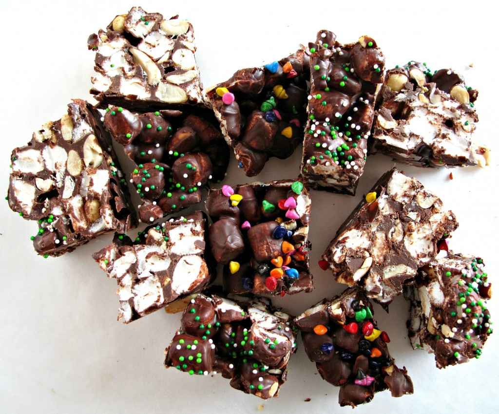 Rainbow's End Rocky Road Candy cut into chuncks showing sprinkles on top and marshmallows inside