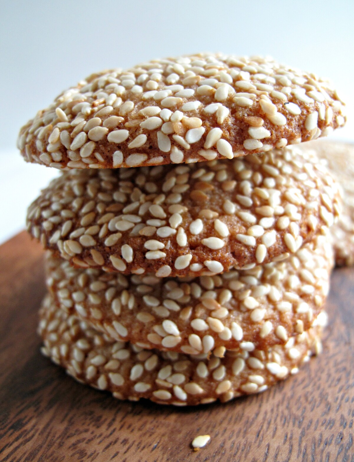 Stack of sesame coated cookies shown from the side.