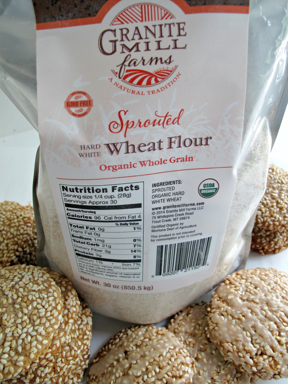 A bag of Granite Mill Farms wheat flour and some cookies.