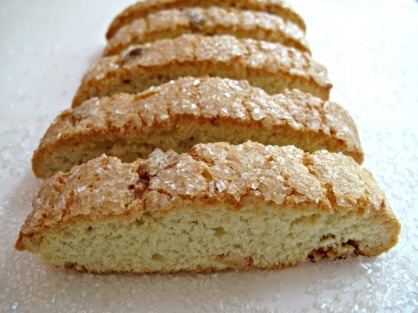 Coconut White Chocolate Biscotti topped with sparkling sugar and no added white chocolate.