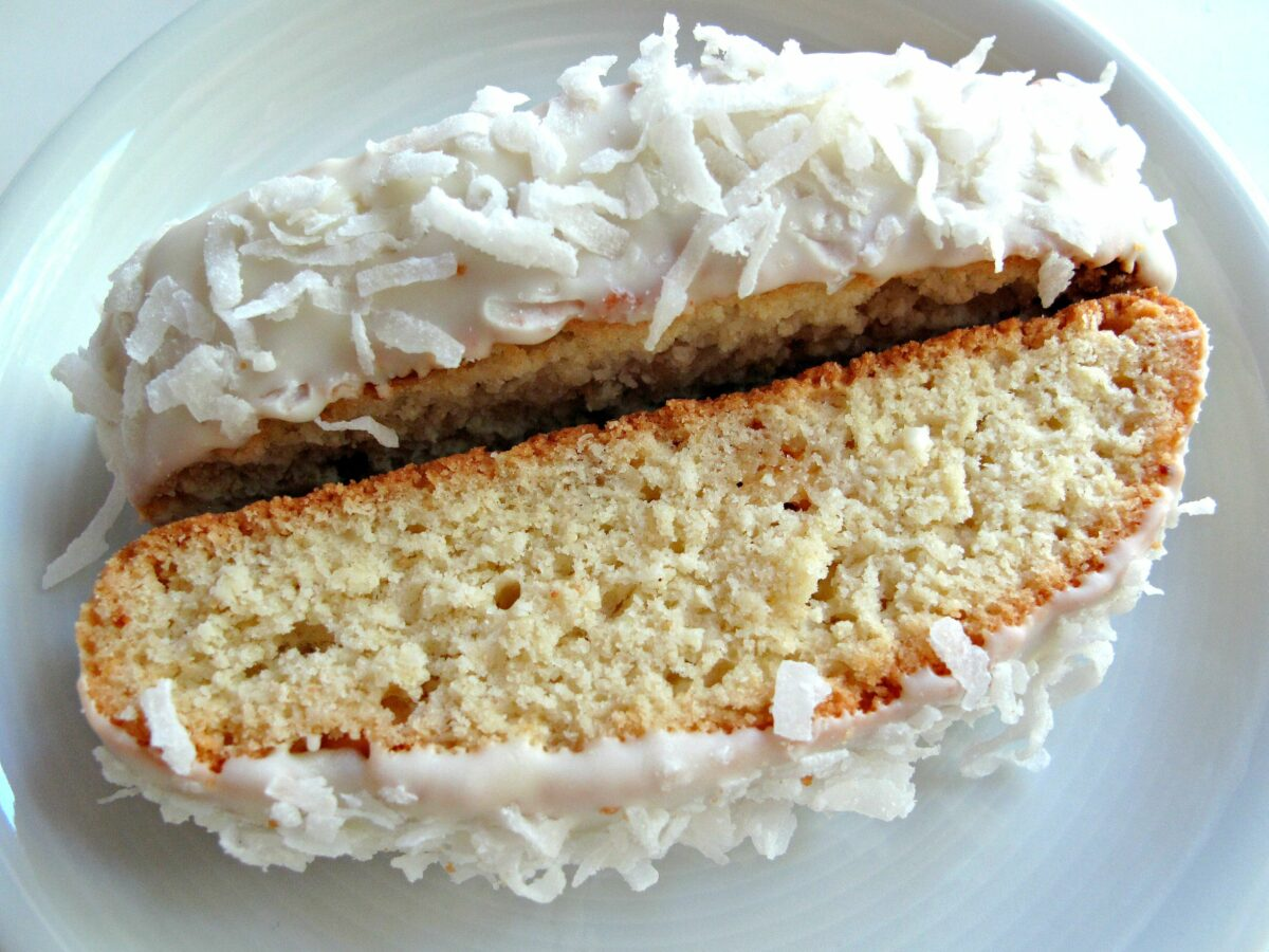 Two biscotti closeup showing crunchy, airy textured crumb.