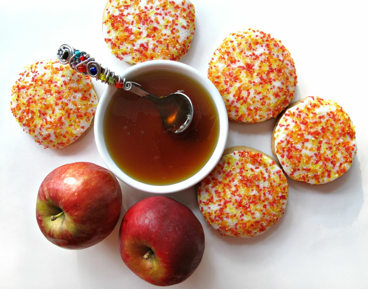 Apples and Honey Cookies, a bowl of honey with a honey spoon and two apples.