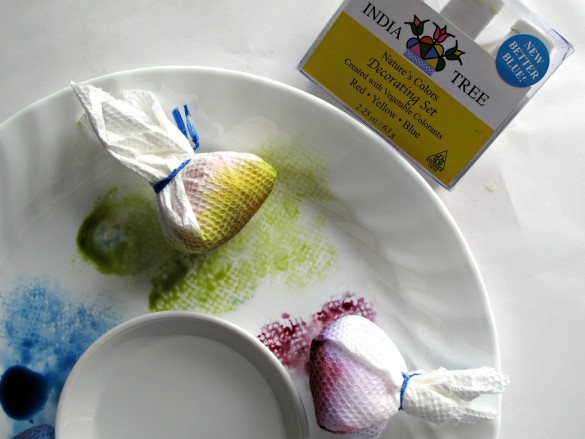 "Paper towels wrapped over balls of plastic wrap form the sponges to dab on the food coloring in a ""sponge painting"" style"