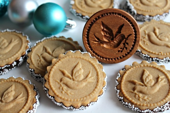 Honey Gingerbread Cookies and a wooded cookie stamp with impression of dove with olive branch