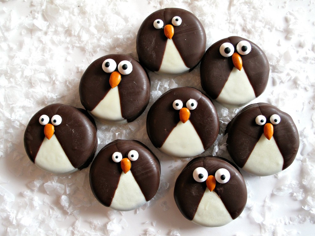 Penguin Oreos dipped in white and dark chocolate with candy eyes and beaks