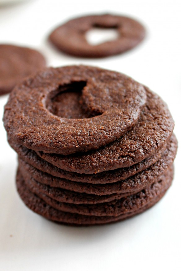 Chocolate wafer cookies, for Chocolate Mint Sandwich Cookies, in a stack. Top cookie has a moon cutout.