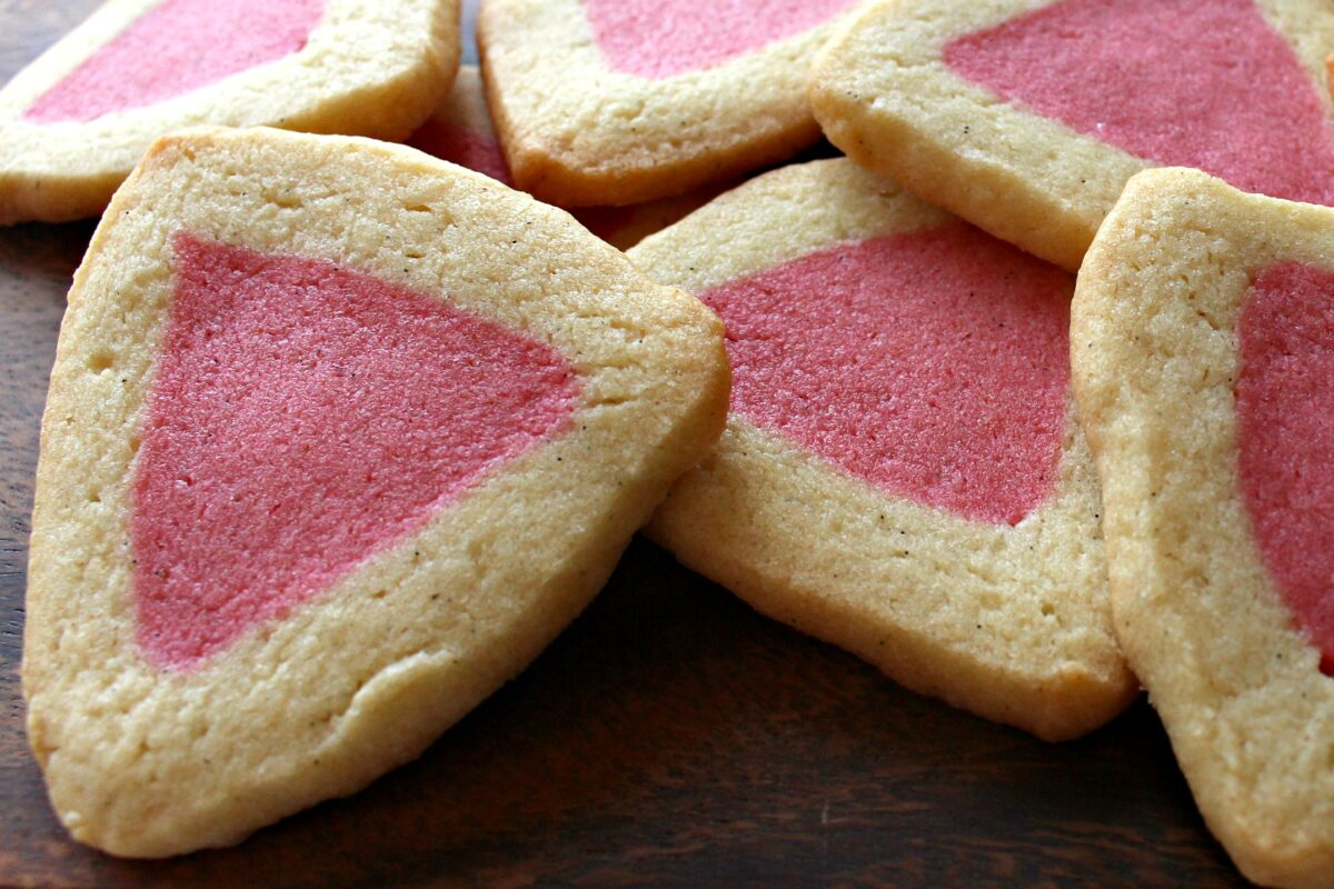 Triangle cookies with pink centers.