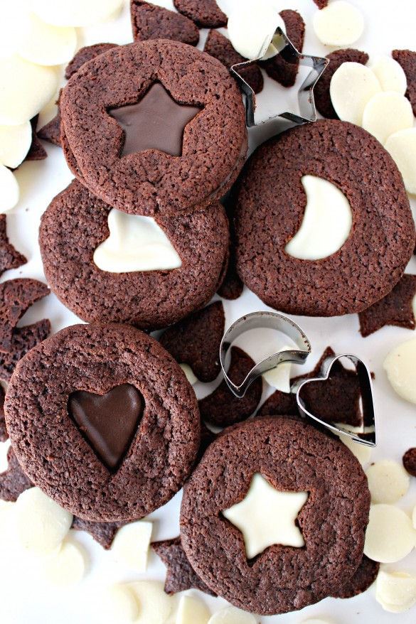 Chocolate Mint Sandwich Cookies with star, heart, and moon cutout centers showing white or dark chocolate filling