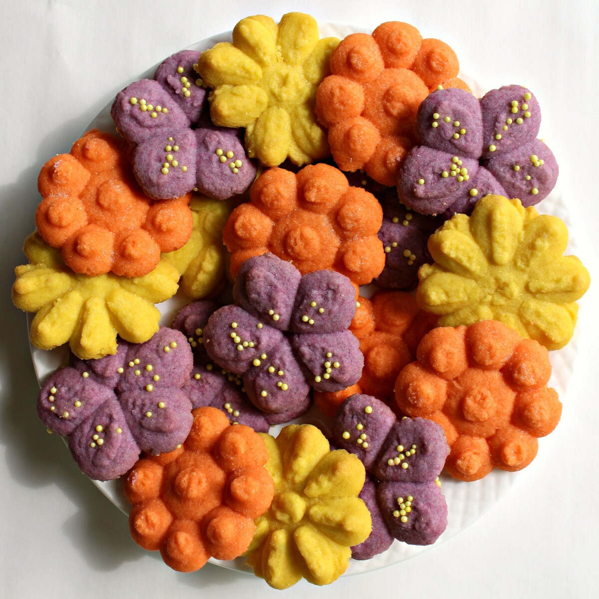 Cookie Press Butter Cookie flowers in orange, purple and yellow.