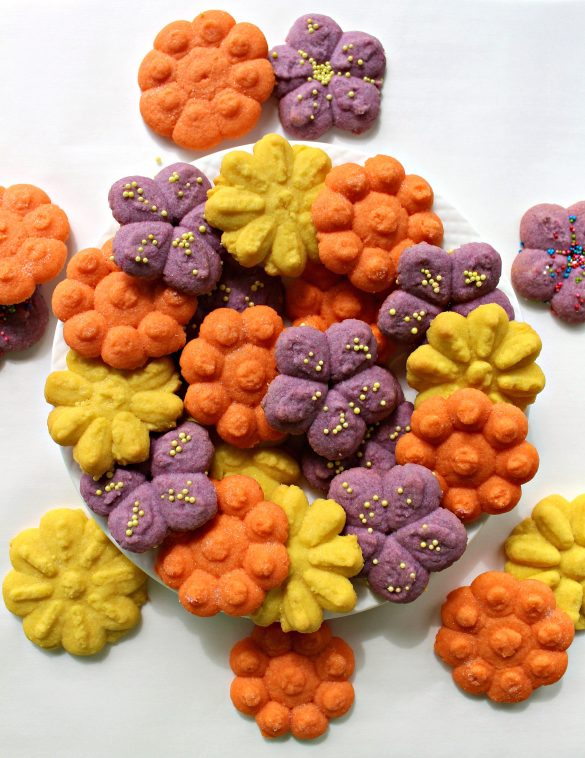 Cookie Press Butter Cookies are flower shaped and springtime pretty. These melt-in-your-mouth morsels are just right for Mother's Day or any time you want to share some baked love. A SURPRISE INGREDIENT makes these cookies quick, easy, AND delicious! | The Monday Box
