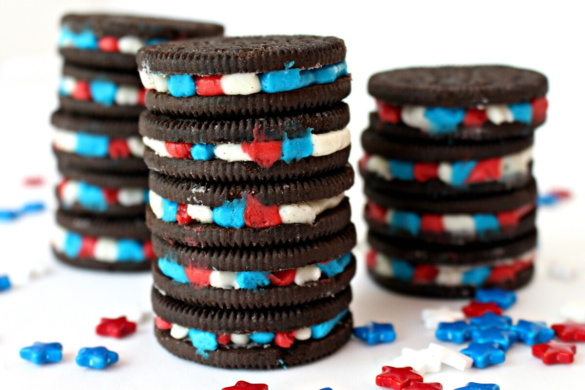 Stacks of Oreo cookies with red, white, and blue filling stripes inside.