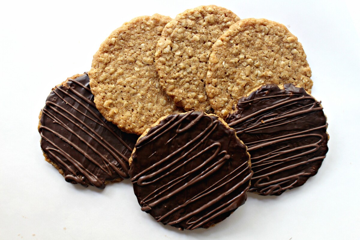 Three oat cookies without chocolate and three with chocolate coating.