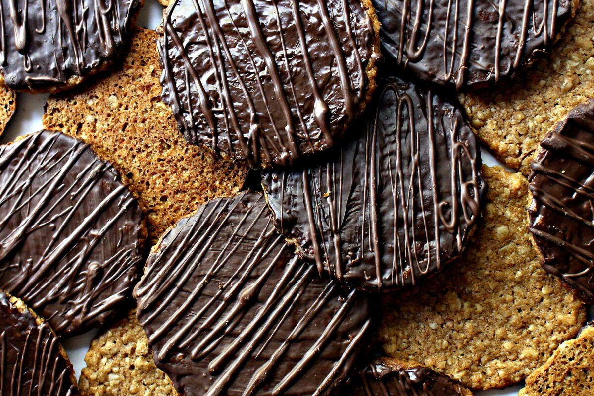 Closeup of chocolate coating on cookies with zigzags of chocolate on top.