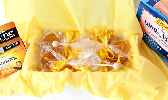 Lollipops packaged in a box lined with yellow tissue to give as a get better gift. with Airborne and EmergenC.