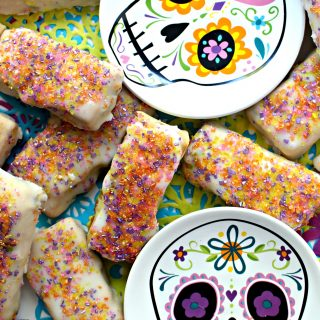 Pabassinas, iced raisin-nut cookies with anise and citrus flavor, are a sweet part of many Dia de los Muertos celebrations.