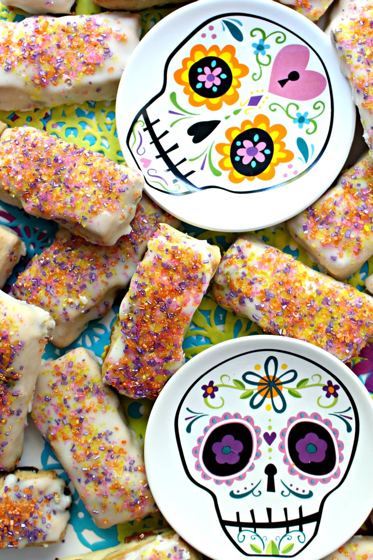Iced raisin-nut bar cookies with colored sugar sprinkles.