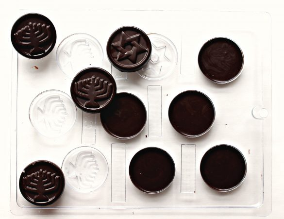 Homemade Chocolate Coins (Chanukah Gelt) in a plastic mold